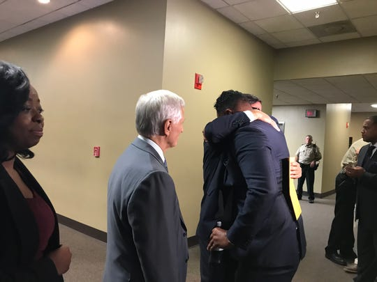 Attorney Art Horne embraces law partner Murray Wells after Horne is found not guilty of aggravated rape, aggravated kidnapping and aggravated assault.