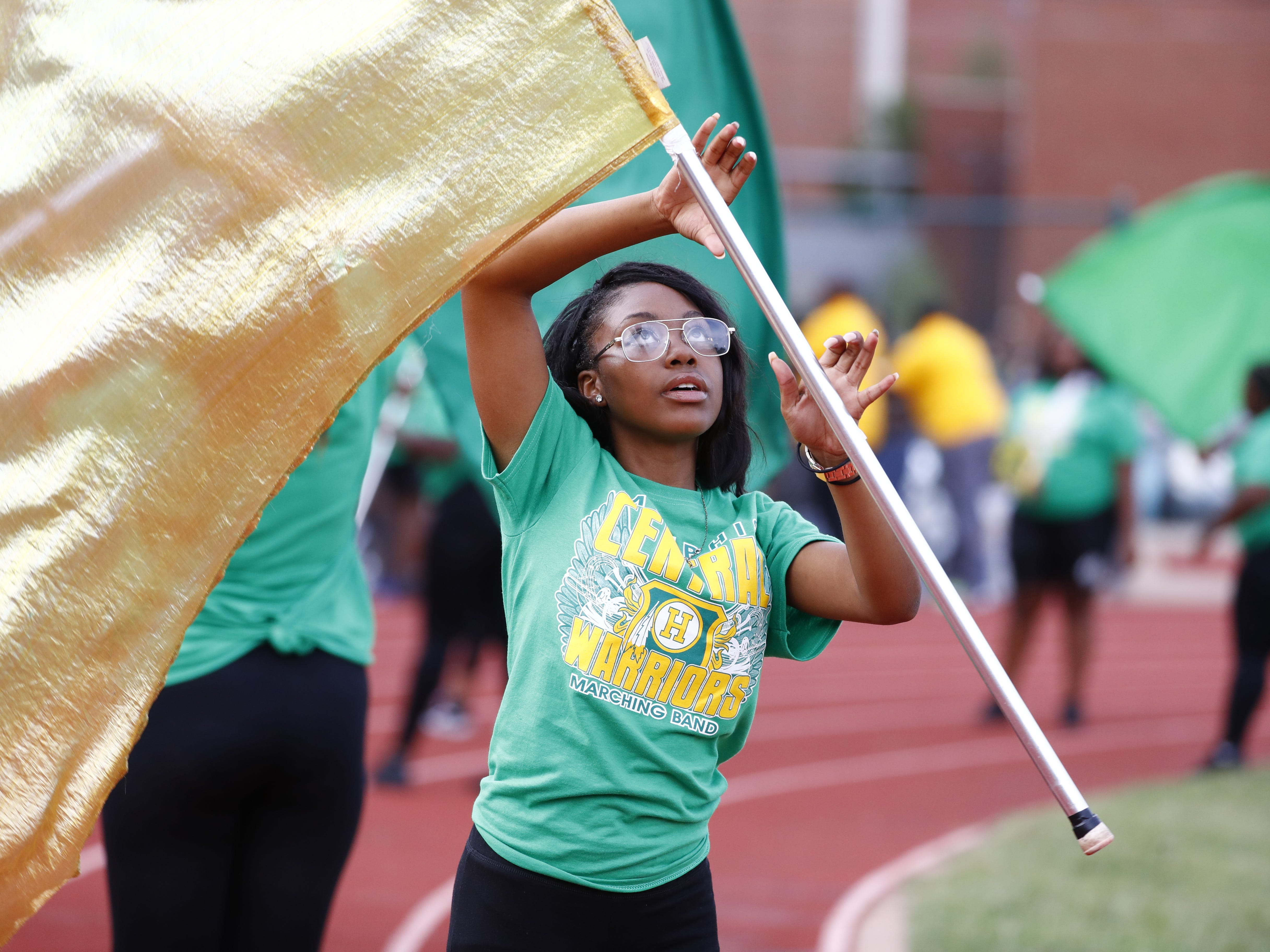 Zanyia Thomas, a sophomore at Central, practices twirling a flag prior to the team's season opener Friday in Memphis.
