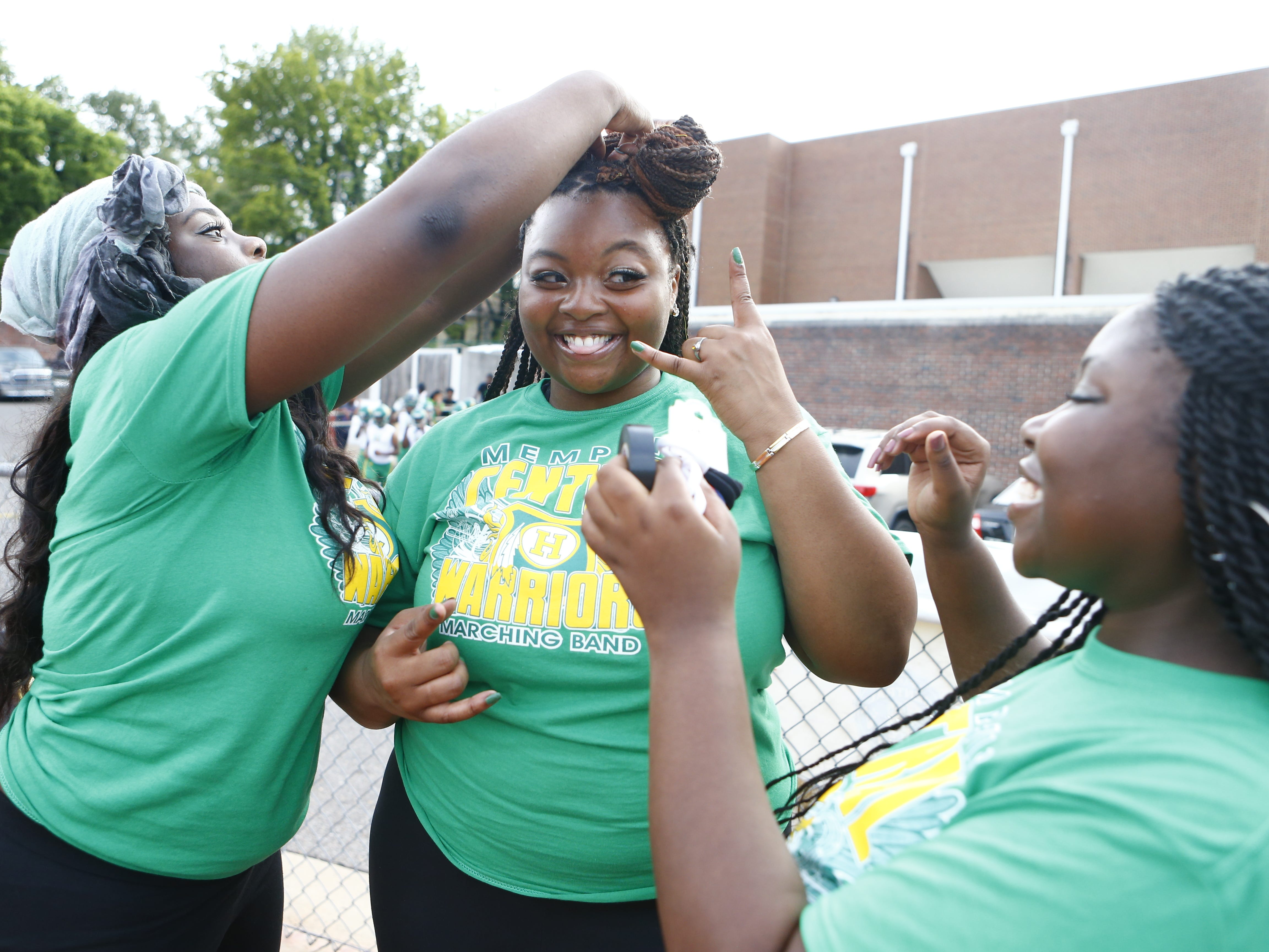 Central football supporters, from left, Kennedy Johnson, Tioni Bruce and Jada Jeffries prepare for Friday's season opener against Melrose.