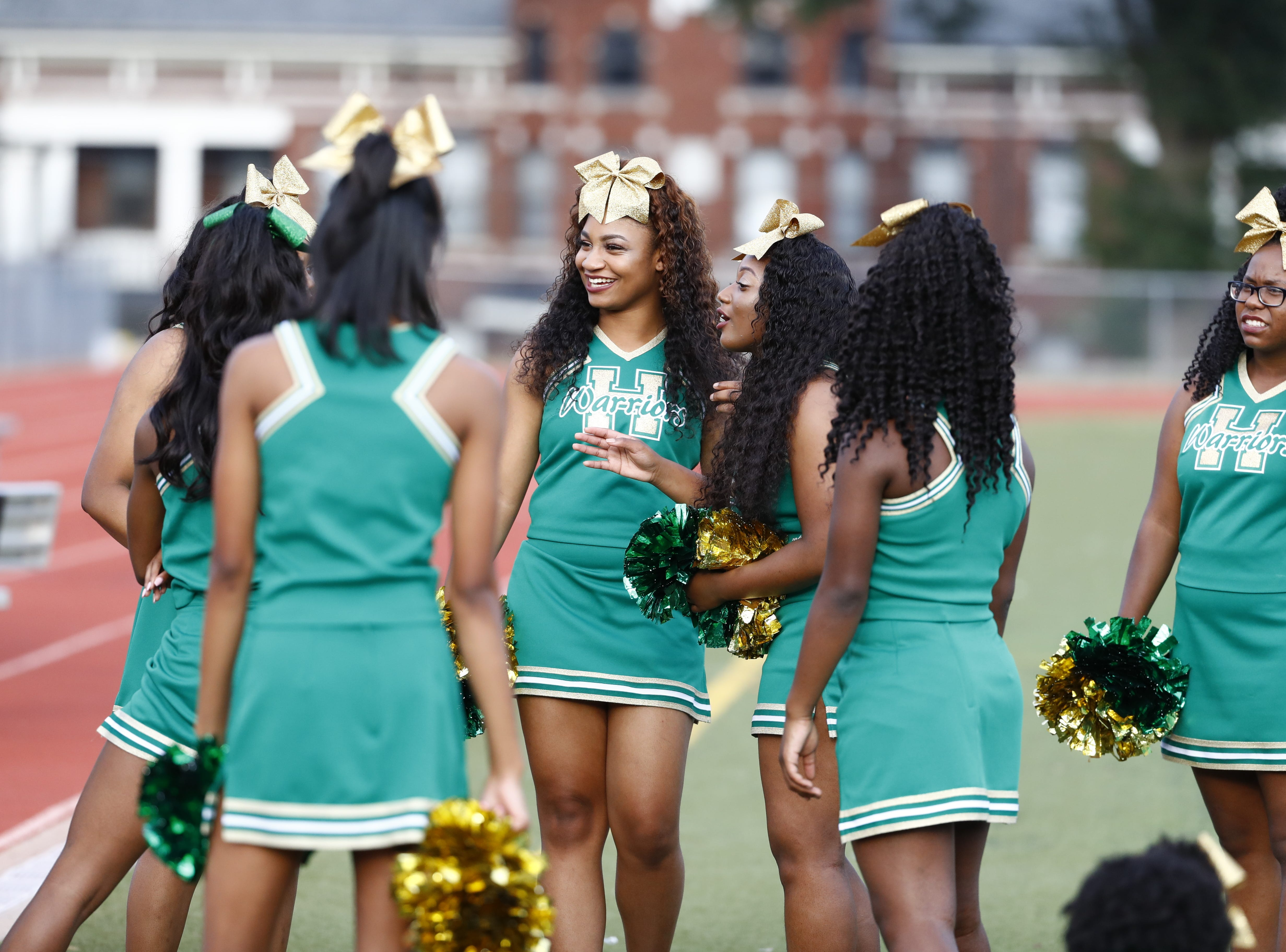 Central cheerleaders gather before Friday's season-opening football game against Melrose on Aug. 17, 2018.