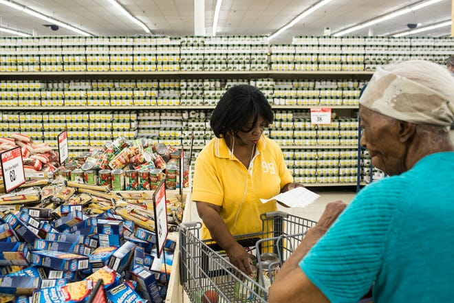 Mary Hayes, left, and her mother, Betsy Crosby, shop at the new Cash Saver supermarket that replaced the closed Kroger in South Memphis along South Third Street. The store opened with much fanfare on Aug. 15.