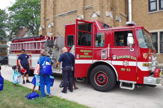 The Milwaukee Fire Department made a visit to the Lisbon Avenue Health Center's health fair. Children were allowed to climb in the firetruck and spray the fire hose.