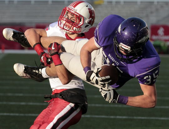 Homestead's Max Pavelec (7) stops Waunakee's Jacob Mehlhoff short of the goal line on fourth down during the third quarter of their WIAA Division 2 football championship game Friday, November 16, 2012 at Camp Randall Stadium in Madison, Wis. Homestead beat Waunakee 14-0.