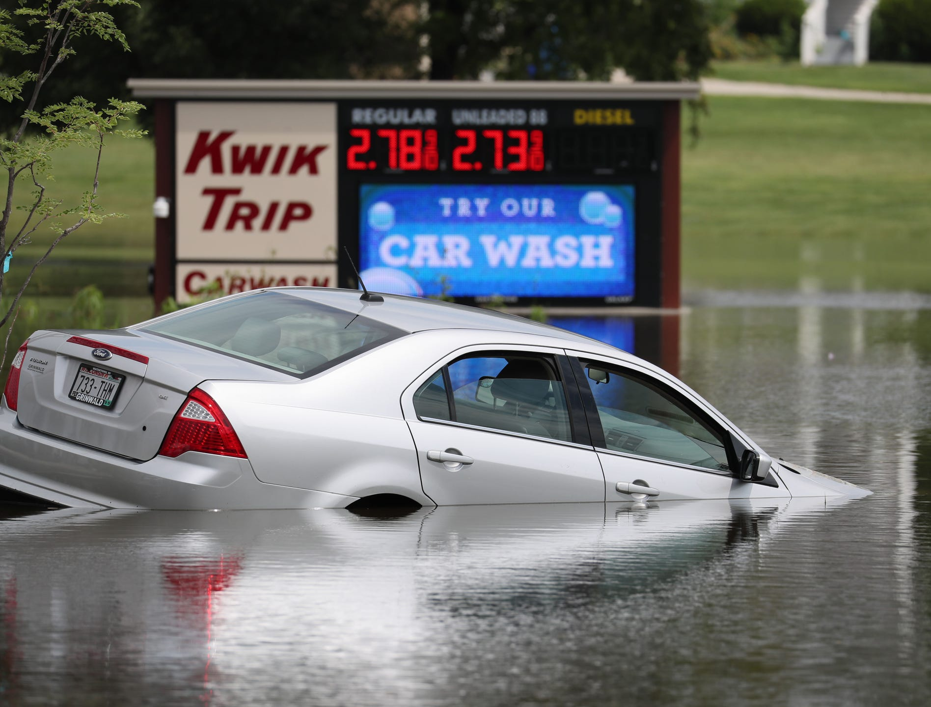 Heavy Rains Cause Flooding Woes - Grinwald ford car show