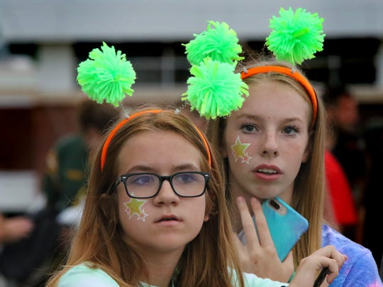 Greenfield freshmen Makenzie Behnke (left) and Courtney Bunnow wait for the start of the Hustlin' Hawks season-opening game against Union on Friday night.