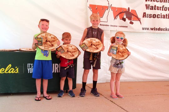 Winners in the youth division hold their awards at the 2018 Wisconsin Duck and Goose Calling Championships organized by the Wisconsin Waterfowl Association.