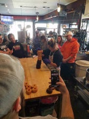 Rachael Cholak stacked 12 doughnuts in one minute. She had to wear gloves so that the doughnuts would be sanitary enough to eat afterward, as per Guinness Record rules.