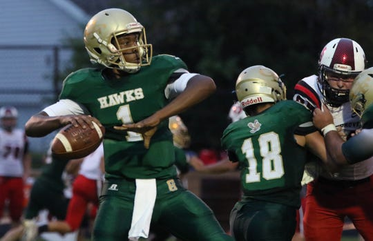Greenfield's Omarion Bartlett sets to pass against Union Grove at Greenfield on Aug. 16.