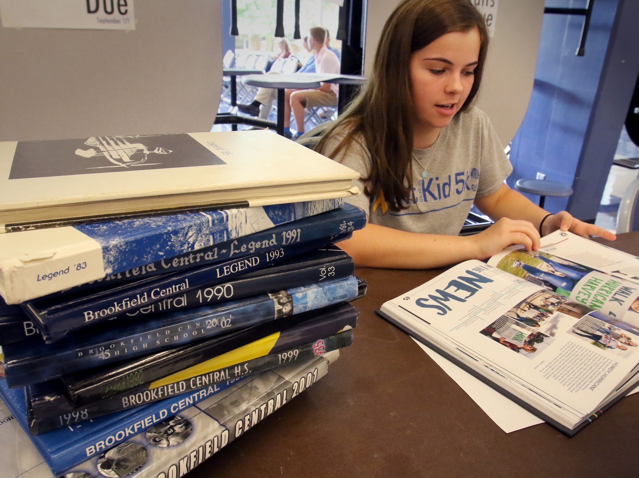 Mary Ellen Ritter, editor for the Legend yearbook, mans a booth during Brookfield Central High School's registration day on Aug. 8.
