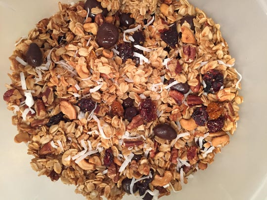 Oats and nuts, dried fruits and chocolate-covered dried cherries all go into this maple syrup-sweetened granola.
