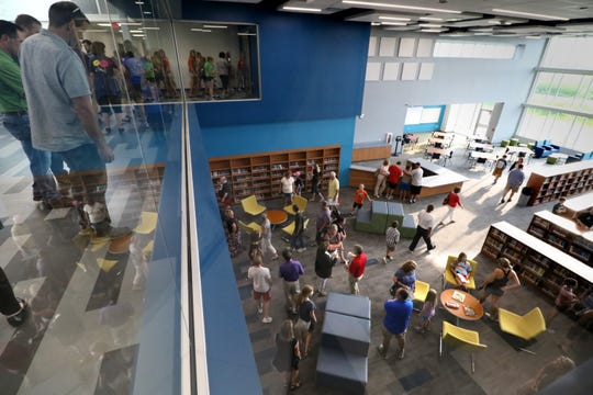 Visitors peer into the Muskego Lakes Middle School library from an upper floor during an open house for the new building on Aug. 14. Muskego-Norway district schools are set to open on Sept. 4.