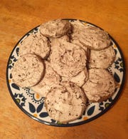 Coffee Break Cookies feature coffee in both the cookie dough and the frosting.