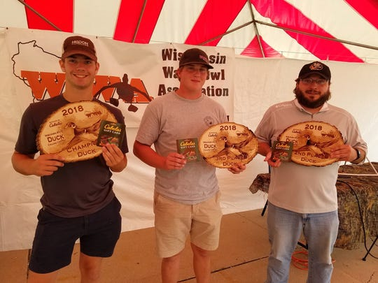 The top finishers in the adult duck division of the 2018 Wisconsin Duck and Goose Calling Championships were Mason Tait (left) in first place, Benny Breitkreutz (right) in second and Jarrett Breber in third.