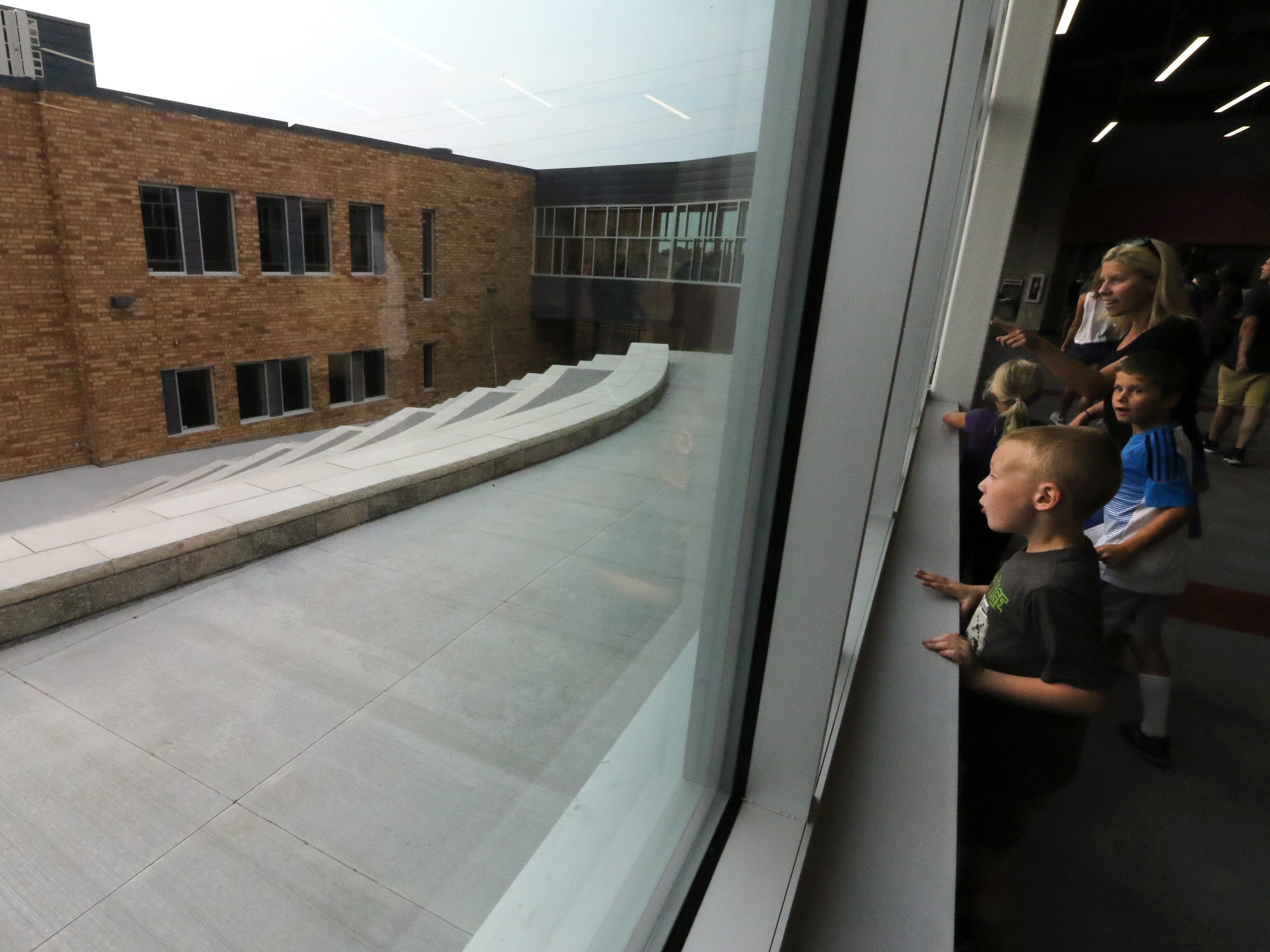 Visitors look at an outdoor large-group area in the courtyard of Muskego Lakes Middle School during an open house on Aug. 14.