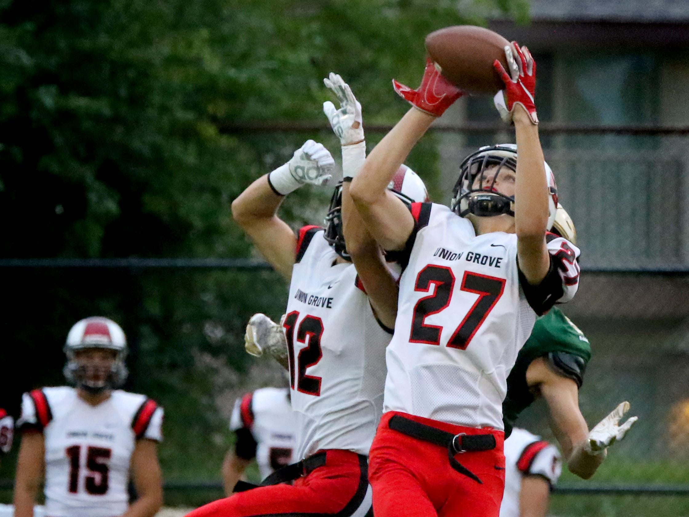 Union Grove's Tommy Hempl makes an interception against Greenfield's Chris Lopez at Greeenfield on Aug. 16.