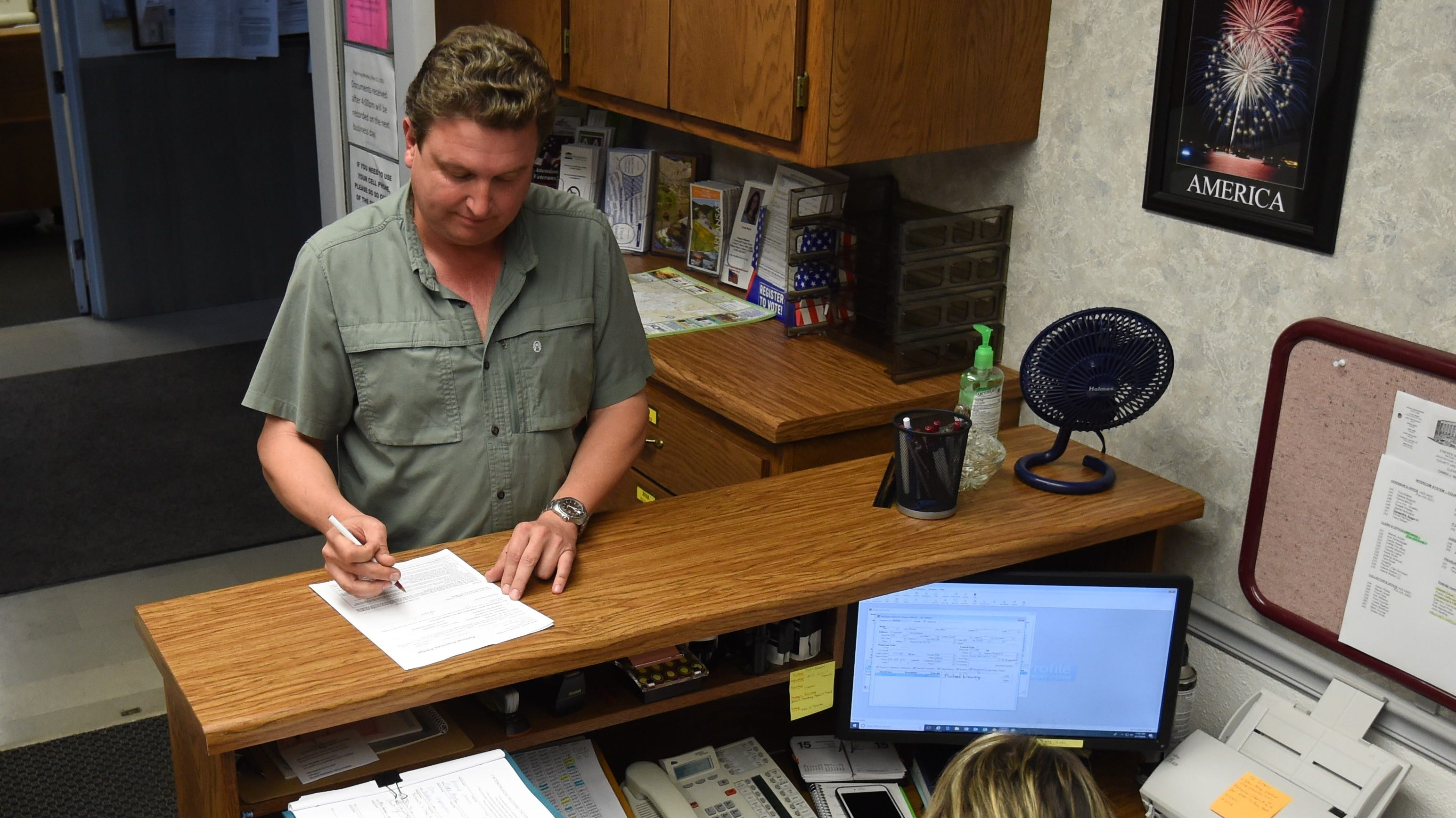 Thom Embach completes his paperwork Friday to run for the Ward 1, Position 2 seat on the Gassville City Council. Friday at noon was the deadline to file to run for a municipal office in November.