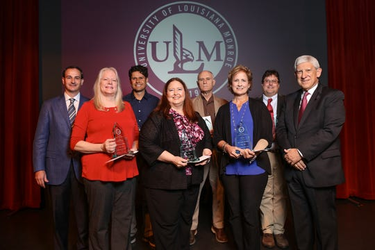 Winners of the ULM Foundation Awards of Excellence are pictured with Foundation board member James Moore III, left, and President Nick J. Bruno, right. The winners include, from left, front, Therese Filhoil, Lillian Brown and Debbie Wisenor, and back, Arturo Rodriguez, Bill Ryan and Chris Gissendanner.