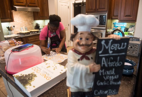 Kamisha Coleman makes candy designs to add to her cupcakes at her home in Montgomery, Ala., on Thursday, Aug. 16, 2018.