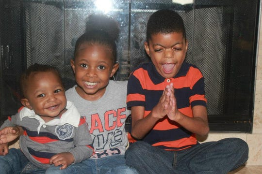 Kamren Dennis with his younger siblings, Reese and Robert Coleman. Kamren died June 19, 2016.
