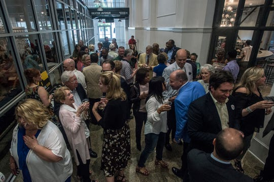 Guests gather at the Kress Building in downtown Montgomery prior to Alabama Shakespeare's announcement of the upcoming season on Thursday, Aug. 16, 2018.