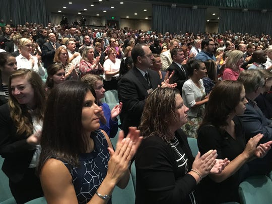 Ball State faculty and staff stand and applaud new Provost Susana Rivera-Mills, a native of El Salvador, at the Fall Convocation on Friday at Emens Auditorium.