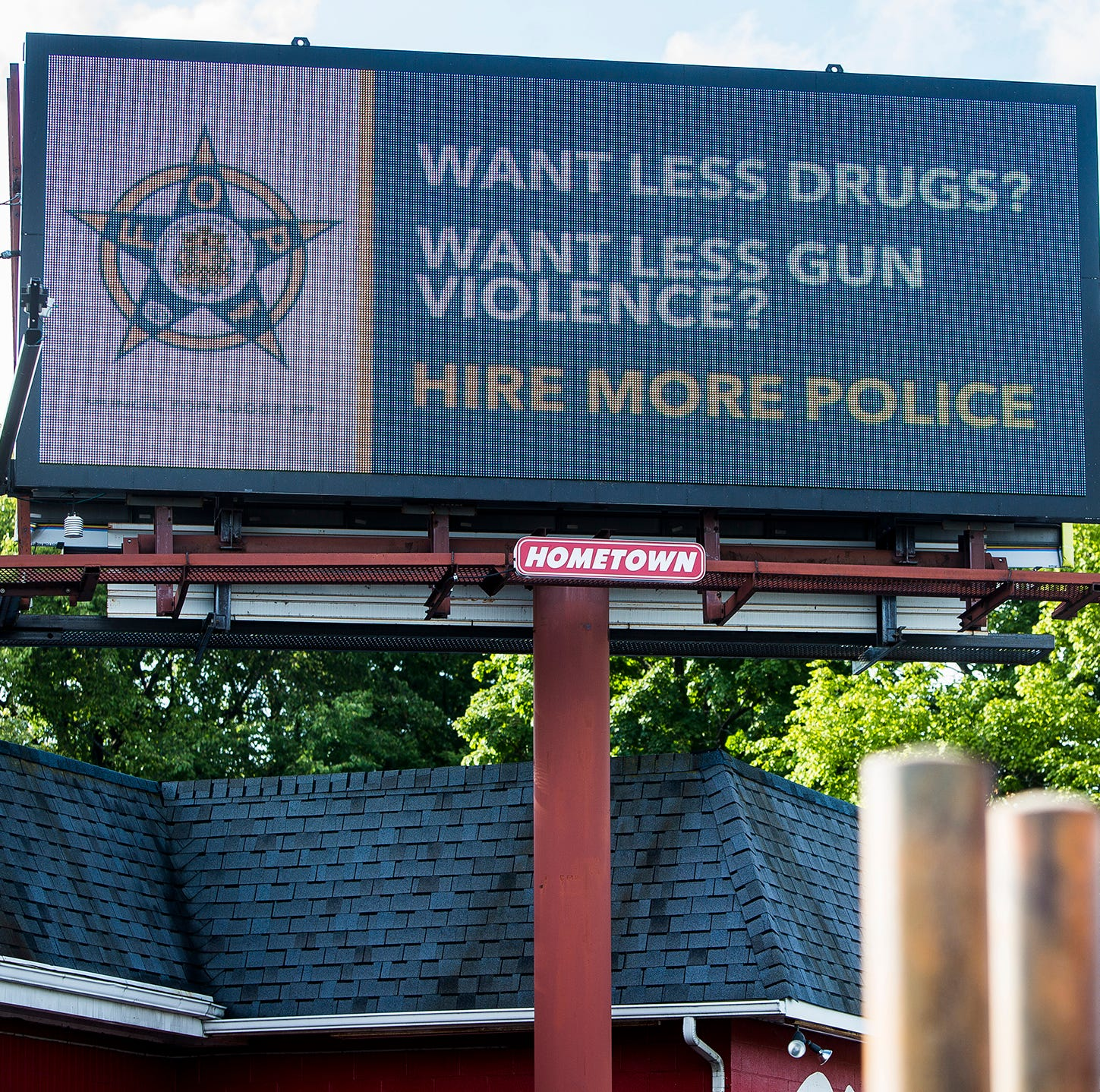 An advertisement paid for by the Fraternal Order of Police appears on an electronic billboard on Wheeling Avenue Friday.