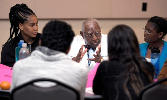 Meharry Medical College professor Dr. Billy Ballard talks with students during a group classroom discussion on Friday, August 17, 2018.