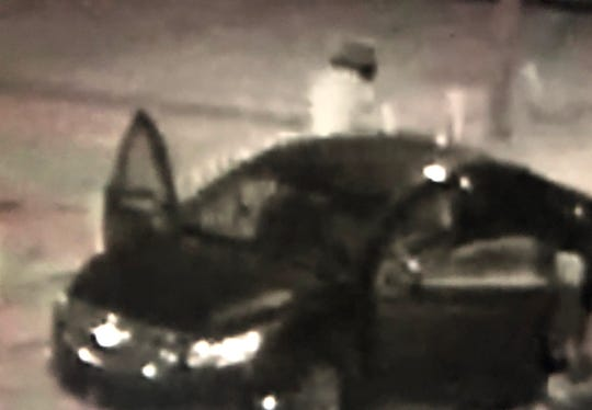 Surveillance photo of the vehicle involved in the shooting at the Cobra in East Nashville. One of the suspects is seen. The vehicle is the parking lot of the bar.