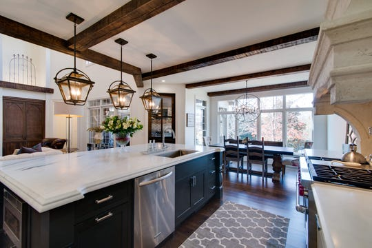 AFTER: This home in River Landing in Franklin was built in 2003 and by 2016, many of the builder-grade elements, even in a higher-end home, became dated. Homeowners removed a curved counter and cabinets and replaced it with a large island to open up the kitchen to the living area.