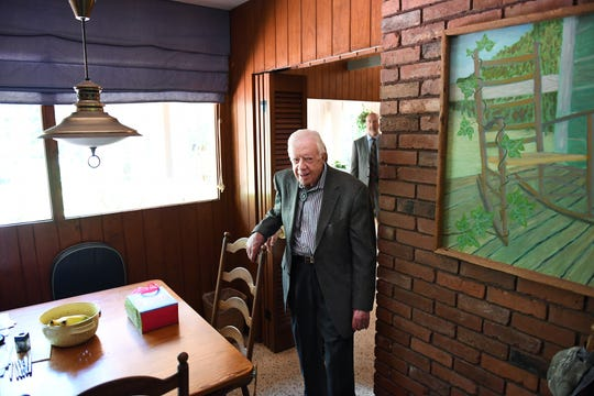Former president Jimmy Carter is pictured at his house after teaching his 800th Sunday school lesson at Maranatha Baptist Church in Plains, Ga.