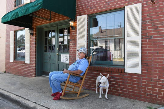 Veterinarian Frank Pierce sits outside his clinic in Plains, Ga.