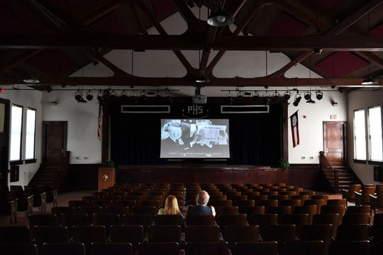 Visitors watch a video about Carter's life in the theater at Plains High School in Georgia.