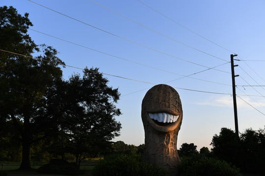 An oversized peanut, made in Indiana as a tribute to Jimmy Carter, stands outside a convenience store in Plains, Ga.