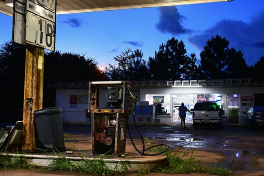 A customer leaves the convenience store, in Plains, Ga. on Tuesday August 07, 2018.