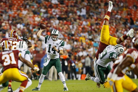 New York Jets quarterback Sam Darnold (14) passes the ball against the Washington Redskins in the second quarter at FedEx Field.