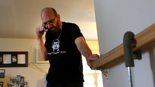 "Victor ""Buddy"" Cordato, a 57-year-old who has Parkinson's disease, talks on the phone with his son. He recently had electrodes implanted in his brain to control the tremors and spastic movements of the disease. On Monday, he is allowing us to see the moment when the deep-brain-stimulation device is turned on."