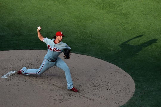Aug 11, 2018; San Diego, CA, USA; Philadelphia Phillies starting pitcher Aaron Nola (27) pitches during the first inning against the San Diego Padres at Petco Park.