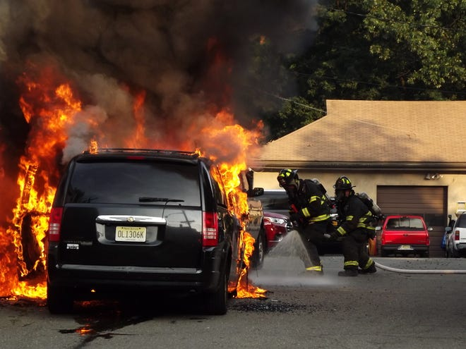 Ridgewood firefighters attempt to put out a mini van that caught fire Friday morning.