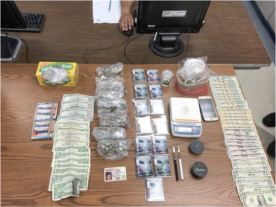 Items seized during a warrant search of a Bloomfield resident's home and car.