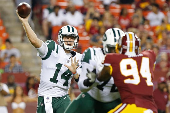New York Jets quarterback Sam Darnold (14) passes the ball as Washington Redskins linebacker Preston Smith (94) defends in the first quarter at FedEx Field.
