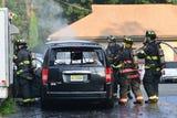 Minivan taxi catches fire in Ridgewood. No injuries.