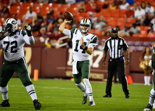 Aug 16, 2018; Landover, MD, USA; New York Jets quarterback Sam Darnold (14) attempts a pass against the Washington Redskins during the first half at FedEx Field. Mandatory Credit: Brad Mills-USA TODAY Sports