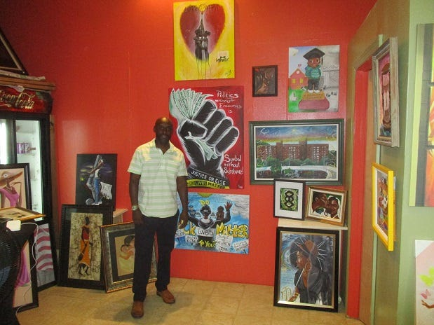 """Christopher Fabor Muhammad said he strives to make his paintings """"culturally relevant,"""" with an emphasis on social justice. His works are on display at the IV Kings ArtFul Xpressions gallery in downtown Paterson."""