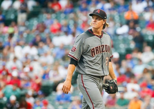 Aug 13, 2018; Arlington, TX, USA; Arizona Diamondbacks starting pitcher Zack Greinke (21) walks to the dugout after retiring the Texas Rangers in the first inning at Globe Life Park in Arlington.