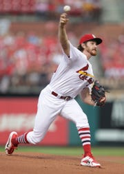 St. Louis Cardinals starting pitcher Miles Mikolas pitches in the first inning of a baseball game against the Washington Nationals, Monday, Aug. 13, 2018, in St. Louis.
