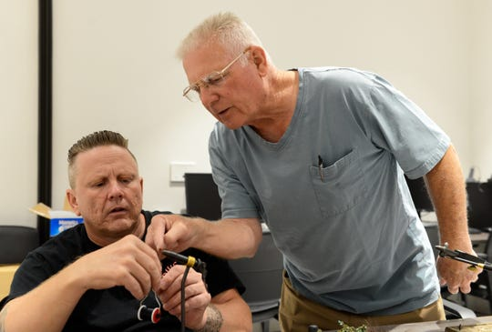 """Ron Bellerose, right, Las Cruces program leader for Project Healing Waters, helps veteran Gary Milne tie a fly at a recent """"Fly Time"""" event."""