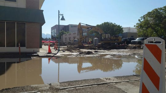 Standing water near the intersection of Las Cruces Avenue and Water Street in downtown Las Cruces on Friday, Aug. 17, 2018 after a storm hit the evening of Aug. 16.