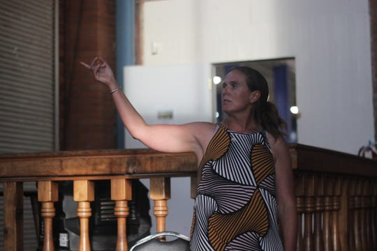 Earthworks Colorado and New Mexico Field Advocate Nathalie Eddy gives a presentation about the potential environmental concerns posed by extraction activities during a public meeting, Aug. 16, 2018 at the Riverwalk Recreation Center.