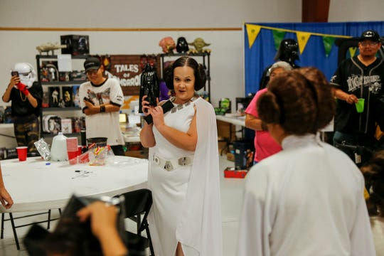 At center, Contest judge Rebekah Garcia talks with contestants Thursday before judging begins for a Star Wars themed costume contest during the San Juan County Fair at McGee Park Convention Center in Farmington.