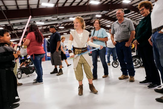 At center, Lauren Cathcart gets ready to participate in a Star Wars themed costume contest Thursday during the San Juan County Fair at McGee Park Convention Center in Farmington.